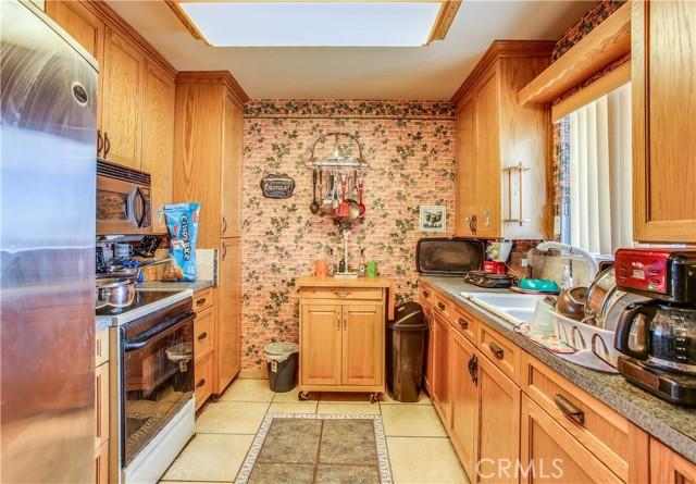 The kitchen has plenty of storage space.
