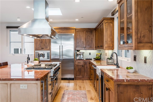 Gourmet kitchen features Alicante marble, stainless steel appliances and a gigantic island, powder room nearby along with open office with amazing views of the water.