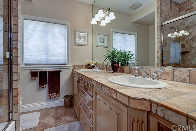 Beautifully detailed full hall bathroom with dual sinks!