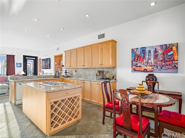 The kitchen has quartz countertops and an informal dining space.