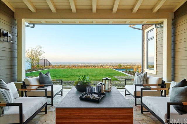 Covered patio off of the great room invites you to enjoy the views. Model home shown.