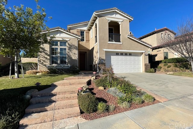"""UNBEATABLE location in Big Sky, one of the most PRESTIGIOUS neighborhoods in all of Ventura county. Open your front door to gorgeous mountain views with no homes in front of you. Built in 2005, this 4-bedroom Spanish-style home beats the location of most million dollar homes in its area. """"WOW!"""" curb appeal. Modern layout with one bedroom and full bathroom DOWNSTAIRS. Spacious master bedroom with walk-in closet. Master bathroom with jetted spa tub and dual granite vanities. Gourmet kitchen with center island, walk-in pantry, granite countertops, GE appliances and lots of cabinets. Cozy family room with fireplace and separate formal dining area. Tile, hardwood and laminate floors throughout the entire house. Energy efficient double-pane windows everywhere. One of the LARGEST BACKYARDS among comparable homes in Big Sky, beautifully landscaped with 9 mature trees, including one pomegranate tree. Private view balcony facing the mountains from one of the bedrooms. Laundry room upstairs with sink and cabinets. Three car garage (tandem). Central location conveniently close to numerous job centers in both Ventura and Los Angeles counties. Moments to the 118 fwy but far enough in a peaceful and quiet area. Beautiful community entrance with waterfall and pond. Trails with picturesque views. Sellers have taken great care of this home. RUN, DON'T WALK… So many benef"""