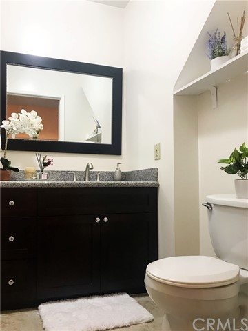 Powder room at the first floor of the unit.