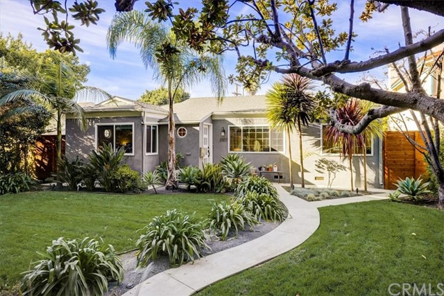 This updated Santa Monica home welcomes you with traditional curb appeal on a tree-lined street and surprises with lots of space, contemporary open floorplan, and designer touches. It's been meticulously remodeled delivering a natural flow optimizing the living space that is filled with natural light. Featuring new hardwood floors, windows and blinds, air conditioning, designer kitchen and bathrooms, and primary suite with an oversized walk-in closet. This home is turn key and will delight all. The backyard is ideal for enjoying SoCal outdoor entertaining with low maintenance landscape and mature fruit trees including avocado, banana, and citrus. Located in Santa Monica, home to award winning schools, and close to the beach, the expo line, and surrounded by three beautiful parks.