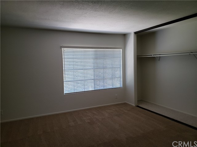 One of the master suites upstairs...with ceiling fan and large window.