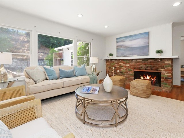 Another view of the living room with a bricked fireplace (fire is photoshoped)