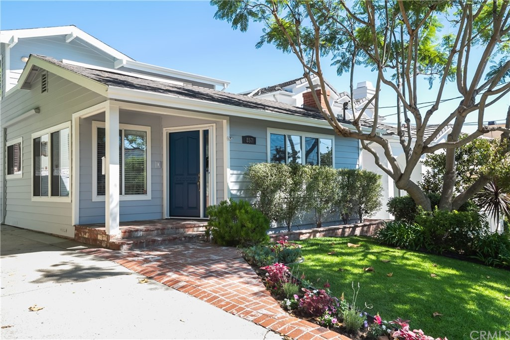 A great opportunity to settle into the Manhattan Beach Hill Section - this classic home gives you everything you need with a spacious kitchen, hardwood floors, large main suite, and fenced back yard. The living room features gorgeous hardwood floors, a stone fireplace, and is lined with windows for added sunlight. An adjacent dining room and kitchen allow you to comfortably entertain guests and dine with family. Two guest bedrooms can also be found on the lower level. The oversized rear guest room offers a walk-in closet, en-suite bath, and its own access to the back yard. Surrounding the rear deck is a two-car detached garage, and grassy yard great for gardening and play. Use the garage for covered parking or design a special bonus space. On the upper level you are greeted by a loft with built-in shelving, wet bar, and doors that lead to the rooftop deck. Easily enjoy this space as a den or in-home office. The master en-suite features cathedral ceilings, walk-in closet, and cozy area for morning coffee and afternoon reading. Relax in the well-appointed bath with dual sinks, separate tub, and step-in shower. Land in a top neighborhood of Manhattan Beach with award winning schools, downtown entertainment, and the beach at your fingertips.