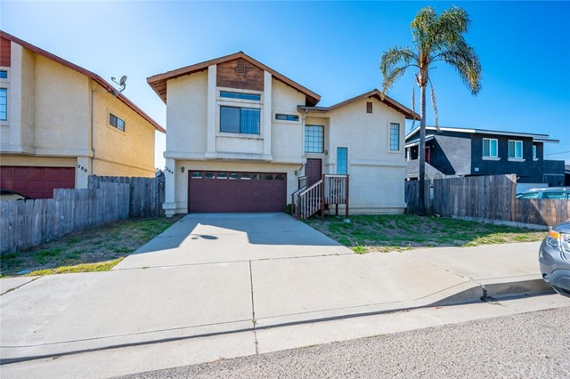 Sweet split level home in the heart of Grover Beach is only 1 mile from our gorgeous California coastline.  Step up on the front porch and be greeted upon entry by two half staircases.  Descend downstairs to lay your head in one of the two lower level bedrooms or freshen up in the full bathroom.  Attached 2 car garage and small fenced backyard can be accessed from this ground floor.  Ascend to the top floor to gather in the sizable Living Room with high vaulted ceilings and brick hearth fireplace.  Open concept floor plan flows from the Living Room to the Kitchen with plenty of space to incorporate a Dining Area or dine casually at the breakfast counter.  Cozy kitchen offers ample cabinets and pantry storage.  The Primary Bedroom is also located on the upper living area, sharing a Hollywood style bathroom with the household.  High ceilings and large windows compliment the spacious Primary Bedroom which has an elongated walk-in closet for your wardrobe.  Located just blocks from Grand Avenue, Ramona Community Park, dining and shopping, this is definitely THE ONE!