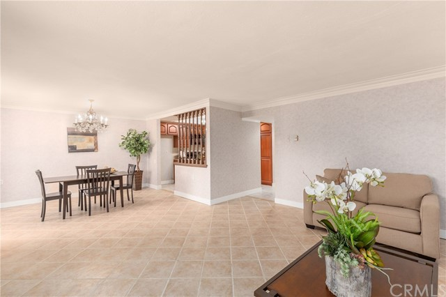 The smooth ceilings and crown molding compliment the spacious living room and dining room.