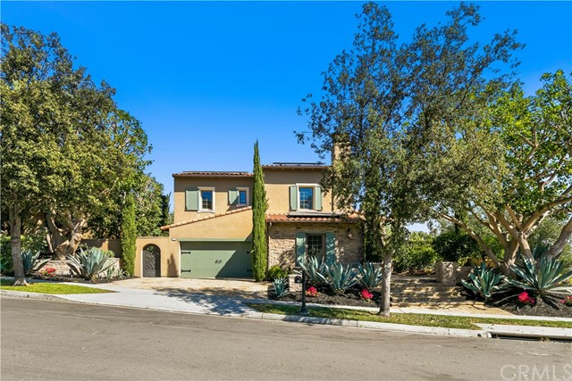 """New PRICE IMPROVEMENT of nearly $270,000 of popular 4,225 SF """"Vicara"""" Plan 3 View Home on one of the LARGEST PREMIUM CORNER LOTS near top of Quail Hill spanning 10,600 SF! Sellers Motivated with replacement home found! RECENTLY REMODELED with spectacular views of city lights, Laguna Canyon Hills & more! Newly renovated 5 bedroom/ 4.5 bath - w/ main floor bedroom and full bath. Private office with french doors to beautifully landscaped backyard. Gorgeous refinished hardwood floors and new custom paint throughout. French Country kitchen with Viking range stove, warming drawer, microwave and SubZero refrigerator. Formal living room with french one doors and fireplace. Elegant separate dining room w/ French Doors overlooking wrap-around yard. Spacious upstairs with 3 additional bedrooms, laundry room, and a stunning Master Bedroom Suite w/ balcony overlooking city lights & backyard. Spa-inspired master bath w/ his & her sinks & spacious closet w/organizer. Enjoy a million dollar view while working out in the private upstairs gym. Backyard boasts covered outdoor BBQ and dining area, fireplace, and imported European Fountain. Charming vine-covered trellis to provide shade for outdoor entertaining. Featuring a 3-car garage. This home has the best of refined luxury in one of the most ideal central Orange County locations - close to shopping, 3 freeways, University High School, and Laguna Beach. Quail Hill amenities include 3 Pools, 2 Fitness Centers, 5 parks, tennis courts, and more!"""