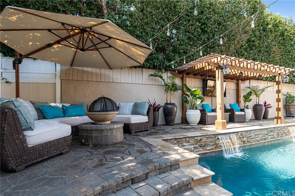 Pergola above the cascading waterfalls in the pool.