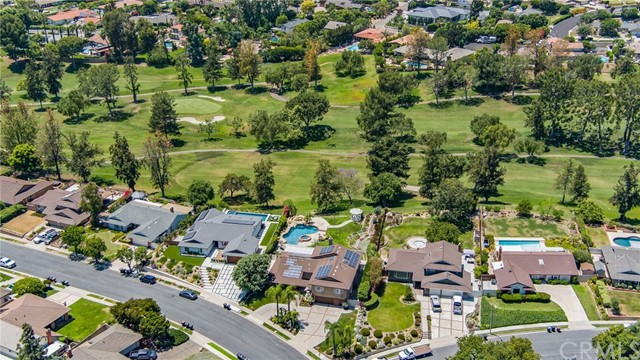 Welcome to the Land of Gracious Living. We are proud to present this beautiful 7 bedroom, 6 bathroom view home that was completely remodeled in 1995. Property sits atop the 14th fairway and 15th green at Yorba Linda Country Club. With nearly a half-acre, this lot boasts beautiful landscaping and elevated golf course and sunset views from the expansive backyard which features, pool, spa, gazebo, and covered patio. The outdoor is plumbed with water, electrical, and natural gas perfect for a future BBQ island or outdoor kitchen. The exterior was recently upgraded with newer exterior paint, an upgraded roof, and new solar panels. The interior has been freshly painted and upgraded LED lighting has been installed throughout as well as all-new white registers, switches, receptacles, and cover plates. Downstairs features the master bedroom and 3 additional bedrooms. Upstairs has a second master suite with a view balcony, an additional 2 bedrooms, and a utility closet with laundry hook-ups. This quiet Yorba Linda neighborhood home offers endless possibilities including a home gym, work-from-home office, small and large gatherings, and much more. Very few homes back the private club and this is your opportunity to own one in a prime location.