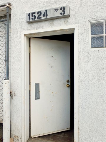 Office entrance door is one of 2 street entrances for 1508 W. 15th St.  (address shown not correct)