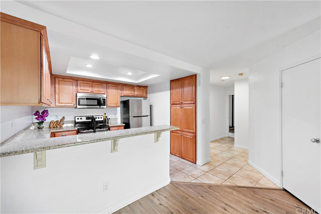 Upgraded kitchen with granite.