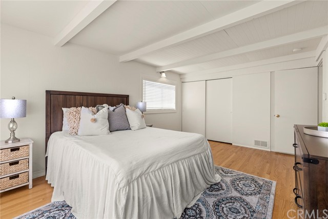 The main upstairs bedroom is spacious, light and bright, with wood beam ceilings, hardwood floors...
