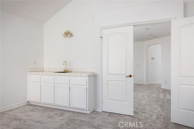 Master suite wet bar and double door entry.