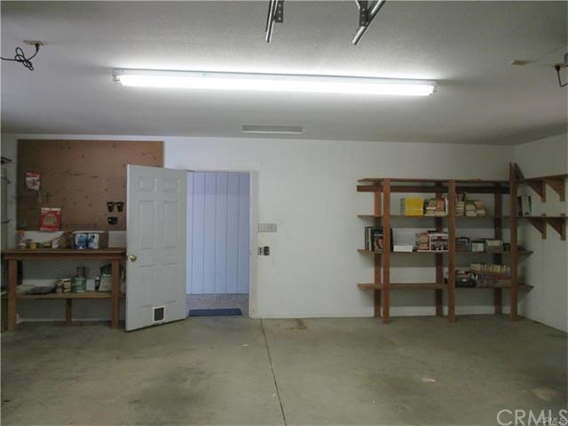 Over sizes garage with work bench and shelving