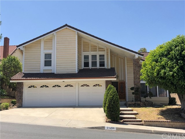 A Spectacular Single Family House is located in desirable area of Diamond Bar. Situating on a hillside and a quite community, the lovely home is close to distinguished schools (Castle Rock Elementary, South Pointe Middle, and Diamond Bar High), recreation parks, shopping malls (walking distance to H Mart market), and easy access to 57/60 Fwy. This two story house features 5 bedrooms, 3 baths, generous great living room with soaring volume ceiling. The family room with a cozy fireplace and a mirror wet bar. The luxury master room with a spacious walk-in closet and large shower & bath tub. Gourmet kitchen. A 3-car attached garage. It has breathtaking sunset mountain view from the back yard. The wall has fresh painted and re-installed brand new wood floor through whole house.