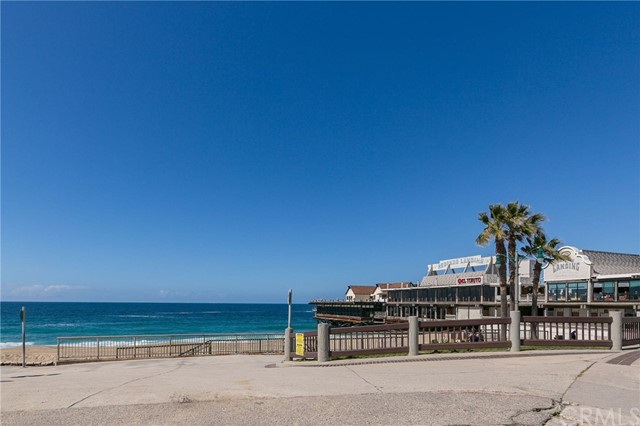 """Just in time for the Summer!  Proudly presenting a rare find in """"THE VILLAGE"""" with its prime location on the 3rd floor with PROTECTED PANORAMIC VIEW OF THE OCEAN, COASTLINE, PV, CITY LIGHTS, VETERANS PARK & THE SAILBOATS.  Extremely private location with no neighbor looking in.  Well-appointed & move-in ready with it's beach retreat design and décor.  A newly remodeled kitchen with gorgeous quartz counter-tops, stainless steel appliances & beautiful distressed wood tiled flooring leading from the kitchen through the hallway into the bathroom. The spacious bedroom has access to the balcony & views as well - plenty of storage space with a walk-in closet, linen, & hall closet. LOW HOA DUES help keep this gated community well maintained at a very reasonable price. One car underground parking and plenty of guest parking as well. THIS OCEAN-FRONT RESORT LIKE COMMUNITY HAS IT ALL. 2 remodeled pool areas, hot tubs, BBQ & eating areas, Fire Pits & State-Of-The-Art-Fitness center all  overlooking the Pacific Ocean. Fitches Kitchen Café & market is also located at the pool level & delivers to your front door.  Steps to Redondo Beach Pier, beach, restaurants, shopping, bike path, endless outdoor & water activities & so close to Riviera Village for additional dining, shopping, nightlife, & entertainment. Whether you're a FIRST TIME HOME BUYER, want a GREAT SECOND HOME, are a SAVVY INVESTOR, or just looking for a FUN BEACH RETREAT at the right price. CHECK OUT THE VIRTUAL TOUR!"""