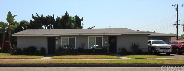 Duplex with 1 Two-car Garages on large lot