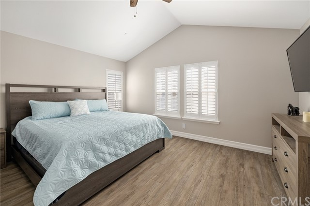 primary bedroom with beamed ceilings and ceiling fan