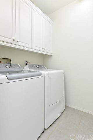 Laundry Room Upstairs with Extra Cabinetry.