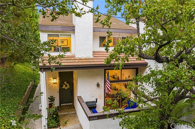 Tucked away in the coveted Highlands of Pacific Palisades, this corner townhouse feels like a single family home.  As you enter, the open floor plan and high ceilings invite you inside where all the entertaining space is on the lower level - including both family and living rooms with built-ins throughout as well as a private patio.  There are two ensuite bedrooms upstairs, including the premier suite which features a dedicated office of generous size.  This townhome has a wonderful location within the complex - it sports the largest garage in the complex with plenty of space for two vehicles plus storage, and only one shared wall.  Additional community features include a large pool, tennis courts, and gym - not to mention the natural beauty surrounding you in the peaceful oasis of the Palisades Highlands.