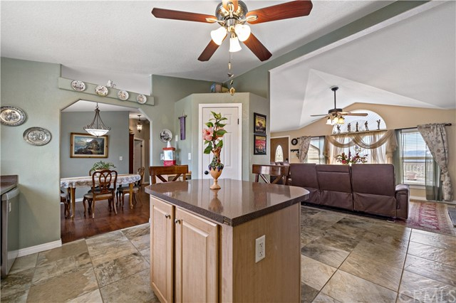 kitchen w formal dining area to left and main living room to right
