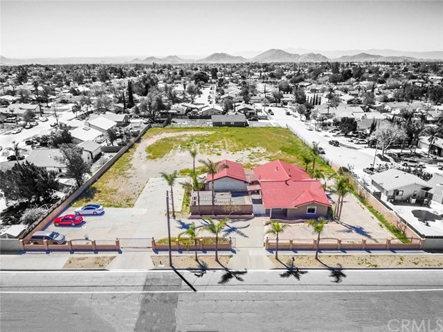 This is a unique opportunity to purchase 1.4 acres of land in the City of Fontana, Ca in San Bernardino County with an existing 1,955sf single family home. The 5 bedroom/2 bath house is remodeled, vacant, and ready to move in with a detached garage, and plenty of outdoor space to meet all your needs.  There is tons of open space throughout with a big living room, formal dining area, laundry room, and a large pantry. The spacious kitchen has quality finishes, granite counters, and stainless steel appliances. Additional features includes a private patio area, tons of cement for additional parking, and raw land in the rear for tons of possibilities. The entire property sits on an enormous 60,984 sf residential lot that backs into a neighborhood cut de sac street which allow potential access and development opportunity to subdivide the land for additional single family homes to be built. Terrific Location in Fontana, Ca on Baseline near Amazon Fulfillment Center, Under Armor & Monster Offices, Major Retailers, Rialto & Ontario Airport, Auto Speedway, Downtown, 110, 15, & 10 Freeways, and Parks & Recreation.
