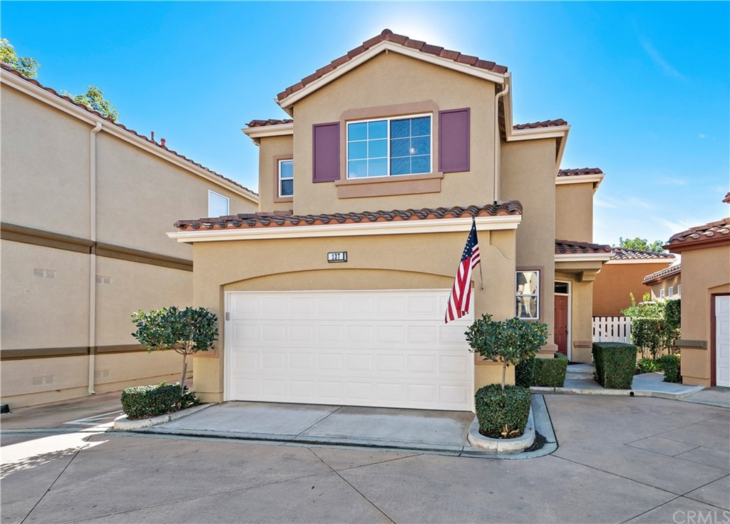 """Absolutely gorgeous DETACHED HOME in Rancho Santa Margarita. This one will not last! So many upgrades! Gorgeous NEW designer wood laminate flooring & larger baseboards installed Jan 2019 throughout the entire house (yes this year)! Barnyard Kitchen remodeled is a chef's delight! Complete w/upgraded super white Quartzite counters/bar, designer brick backslpash, barnyard wire display cabinets, all stainless appliances, matching hardware/upgraded faucet & topped off w/a perfect farmhouse sink! This home is """"Barnyard meets Chic!"""" But there is more…downstairs open concept has a living room, kitchen & dining area w/wainscot wall décor, additional recessed lighting, a cozy fireplace for cooler evenings & lg designer framed windows that bathe the living area w/bright sunshine. Large sliding glass doors open to a """"L"""" shaped private backyard w/interlocking pavers, a lovey grass & garden area. It's the perfect place to relax, BBQ & enjoy life w/friends. This 2½ bath has 3 spacious rooms upstairs. A private master suite w/walk-in closet & master suite bath area upgraded w/cabinet Barndoors next to mirror, above the dual vanity sinks. Just awesome! Down the hall are two more spacious rooms giving the master privacy. Professionally painted interior & exterior, ceiling fans thru-out & remodeled powder room downstairs. TWO car attached garage w/laundry area. Close to RSM Beach Club/Lagoon,schools, parks, pools, tons of shopping & restaurants, Cinepolis Luxury Theaters & the 241 toll."""