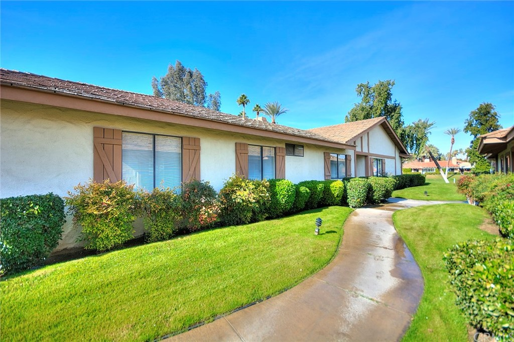 Exclusive Monterey Country Club. Spectacular golf and mountain views! Fantastic value! Motivated and reduced for quick sell. Large spacious open floor plan. Light and bright with vaulted ceilings.. 2055 sq. ft. 3 Bedrooms (one is currently used as a huge family room) and 3 baths. Kitchen upgraded. Fireplace in living room overlooking the patio and atrium. Wet bar. Separate dining room. Kitchen and breakfast nook overlooking the lovely patio. Inside atrium brings in added light.. Separate inside laundry room. Beautiful spacious master suite . Master bathroom has double sinks, vanity, separate shower and Roman tub.Two car garage.End unit.  Short walk to pool and spa. Guard gated community.24 hour security. 27 Hole Championship Golf Course designed by Ted Robinson. 17 Tennis Courts (10 lighted). Pickleball. Bocce Ball. 37 Community Pools. Mountain & fairway views. Recently renovated Fitness Center. Full service Golf and Tennis Pro Shops. Clubhouse featuring formal dining, patio snack bar, lounge and many special events and activities. Attached 2 car garage. Located minutes from shopping, dining, McCallum Theater,College of the Desert and entertainment. Association fee includes building insurance, roof maintenance,exterior painting,cable TV (HBO,Showtime,Cinemax),trash pickup, common area landscaping and irrigation, 24 hour Guarded Gate and Security Patrol.