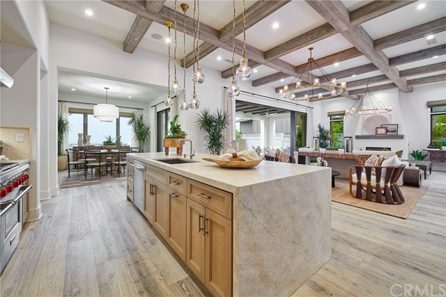 Kitchen opens to great room, dining room with a view. Model home shown.