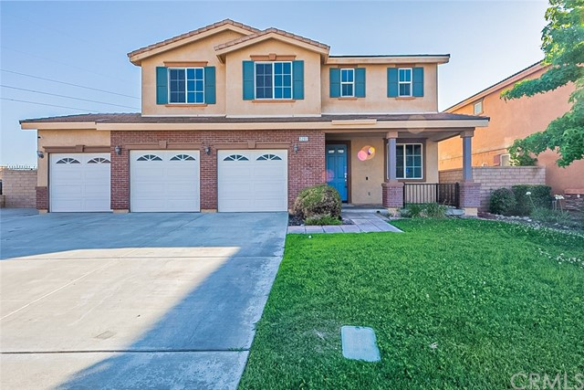 This Fontana two-story home offers granite countertops, and a three-car garage. This home has been virtually staged to illustrate its potential.