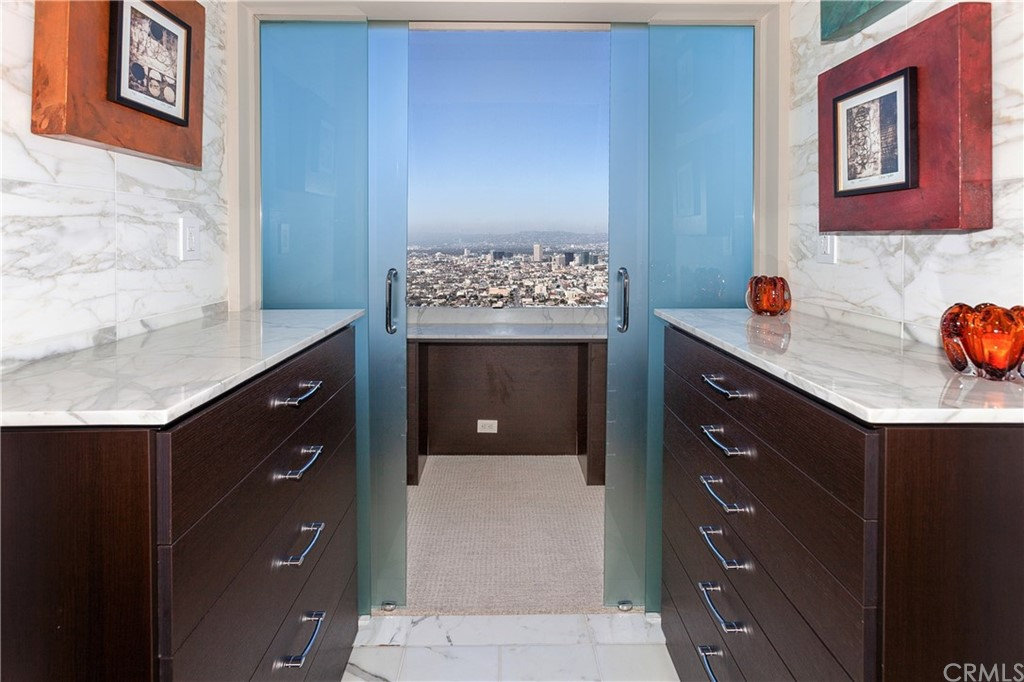 Master dressing area and walk-in closet with views to the ocean