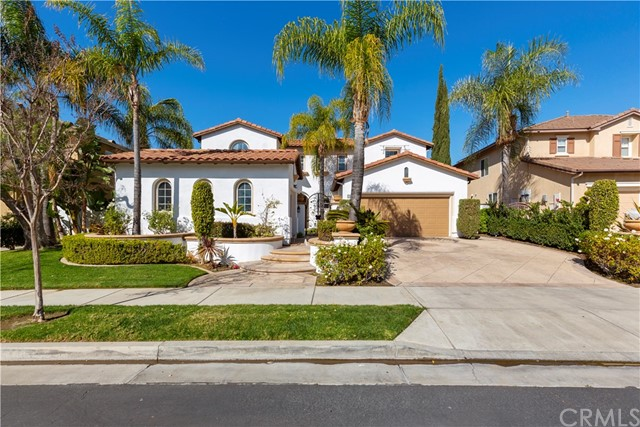 This beautiful Tuscan style house is located in Parkhurst gated community with an excellent Cul-De-Sac lot. This house features 4 bedrooms, 3.5 bathrooms, 3,722 sqft living space, and 12,150 sqft lot. Newer interior paint! You can see pool views and lush fountain through all windows on the main floor. It has charming front courtyard, an iron gate entry, high ceilings, tile flooring, gourmet kitchen with granite counter, and chandeliers. A main floor game room is suitable for billiard and other entertaining purposes with recessed lights and surround sound. The spacious backyard is good for gatherings with patio, barbeque, dining bar, private waterfall pool, and heated spa. The swimming pool comes with built-in fences. Great location to awarded Yorba Linda school district, restaurants, and markets. The amenities of Parkhurst community include tennis courts, volleyball courts, basketball courts, clubhouse, pools, and spas.