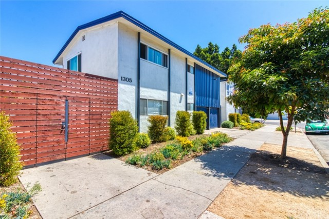 1315 W. 19th Street is a 22-unit multifamily asset in Long Beach, California. The property is situated on an oversized corner lot, and offers an attractive mix of two 1 BD / 1 BA, sixteen 2 BD / 1 BA and four 3 BD / 1 BA units as well as fourteen garages and on-site laundry facilities. Half of the unit interior have been fully renovated with new laminate hardwood flooring, custom shaker-style cabinets, quartz countertops, stainless steel appliances, new bathroom tile and modern lighting, ceiling fans and fixtures throughout. Exterior upgrades include light landscaping and new front and rear building security gates. 1315 W. 19th Street presents a rare opportunity to own in an area of Long Beach where few apartment buildings come on the market. The asset is 95% occupied and offered at a 5.27% cap rate and 12.25 GRM on actual rents, with potential rental upside of +/-14%.