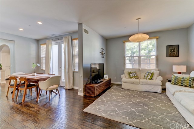 Light and airy living space with living room flowing into dining area. Gorgeous wood floors downstairs and neutral paint color throughout. *Note - home does not currently have furniture/decor.