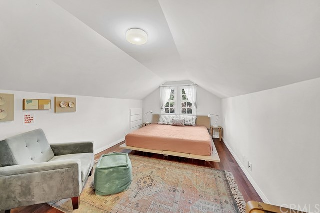 upper bedroom is spacious and has partial concept drawings to add a half or 3/4 bath