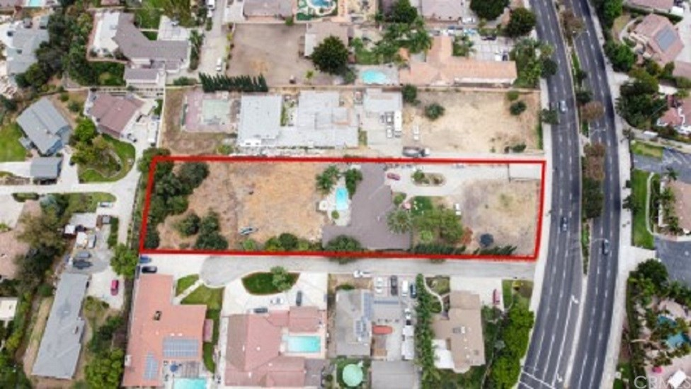 ** RARE FIND** OVER 1 ACRE (52,621 SQ FT LOT) WITH A HOME NESTELED IN THE MIDDLE OF YOUR ESTATE. OR FOR A DEVELOPER THIS IS YOUR OPPORTUNITY TO BUILD 3 HOMES ON THIS PROPERTY. THE 2,965 SQ FT. HOME HAS 3 BEDROOMS, 3 BATHS, OPEN KITCHEN, AND POOL. THERE SO MUCH POTENTIAL WITH UPDATING. THE PROPERTY BACKS UP TO ONE OF LA MIRADA'S FINEST NEIGHBORHOODS, 'CREEK PARK EQUESTRIAN ESTATES'. IT IS ZONED 'FARM ANIMAL ALLOWANCE' AND (2) HORSES ALLOWED FOR EACH 10,000 SQ. FT. WITH PROPER SET BACKS. DEVELOPERS: SELLER HAS PRELIMINARY APPROVAL FROM THE CITY FOR LOT SPLIT TO INTO 3 PARCELS APPROX. 15,000; 17,000 AND 23,OOO SQ FT EACH. NEIGHBORING LOT WAS PREVIOUSLY DEVELOPED INTO HOMES AND A PRIVATE STREET YEARS AGO. THIS PROPERTY IS WAITING FOR THE RIGHT BUYER – IS THAT YOU!