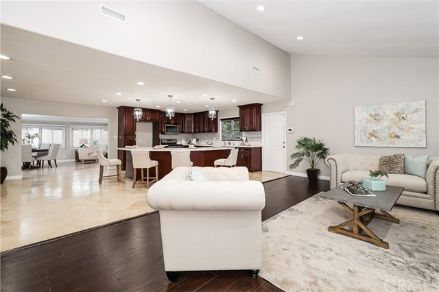 This gorgeous home located in a very desirable neighborhood of Orange county on a quiet Cul de Sac is ready and waiting for you. Boasting 2076 sq. feet. This 3-bedroom two bath home has been turned into a turnkey huge open floor plan home, from the remodeled bathrooms to the upgraded kitchen. This home is perfect. All new ceiling fans, blinds, Quartz counter tops, all new paint, new laminate wood floors and so much more. Retire to the expansive living rooms for rest and relaxation. Yes! we said living rooms! There are two large living rooms. The back yard has professional landscaping and a beautiful pool! This home is located near Chapman College and Old Towne Orange. Perfect for evening strolls throughout the neighborhood! This turnkey home is ready go. Just move in and relax because you are home!