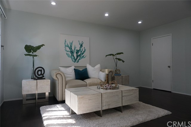 Beautiful 1 bedroom unit, fully renovated bathroom and kitchen with quartz countertops.  Viking refrigerator, cooktop, microwave hood, new interior plumbing and electrical (2 years old), refurbished hardwood floors, upgraded lighting, plenty of storage, gated courtyard, onsite laundry.  Located within 3 blocks of the beach and near to many restaurants, shops, stores and public transportation close by.