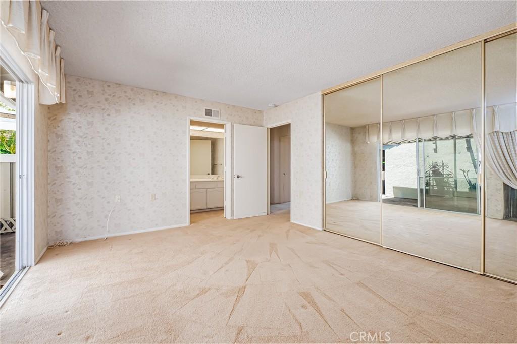 Master Bedroom Sliding Glass Door into Front Patio