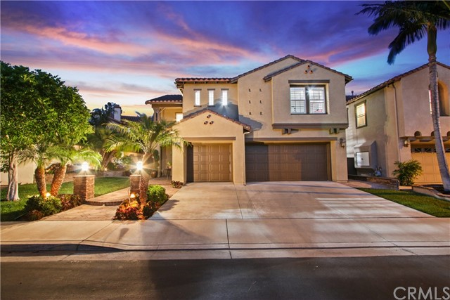 "Nestled in the Guard Gated Community of ""Sedona"" this Fully Upgraded Italian Villa Inspired beauty is Move In Ready! The Elegant Interior offers an Open Floor Plan, Vaulted ceilings, 4 Bed (+ Loft & Den), 2.5 Bath, 2400 Sq. Ft, 3 Car Garage & 4,500 Sq. Ft Lot. Enter through the Breathtaking front yard. Inside,Soak in the Natural Light from the Wall 2 Wall Windows & the Majesty of the Vaulted Ceilings. The 1st floor offers a Formal Living Rm, Formal Dining Rm, Bed/Office, Powder Rm, Gourmet Kitchen w/ Mahogany Cabinets, Granite Counters w/ Natural Stone Back-splash, Island w/ Breakfast Bar, Stainless Steel Appliances & Pantry. The Family Rm features a Built In Mahogany Entertainment Center, Granite Fireplace, & French Doors. The 2nd floor offers a Master Suite & Bath w/ Vaulted Ceilings, Walk in closet, Dual Sinks, Natural Stone Shower & Jetted Jacuzzi Tub. There's a Loft, Separate Den, 2 Beds, Hall Bath& Laundry Rm. Interior upgrades include; Marble & Berber Carpet floors, Designer Paint, Custom Windows, Crown Molding, Upgraded Baseboards, Wired for Surround Sound, Recessed Lights, Shutters, Ceiling Fans, French & Panel doors w/ Custom Molding, Mirrored Closet Doors & more. The Backyard is an Entertainers Paradise, complete w/ Paver floors, Brick Planters, BBQ,Mature Trees & Shrubs, Brick Fence & Custom Wrought Iron Door. + Enjoy community amenities including, Pool & Spa, Award Winning Schools, Nearby Parks, Biking & Hiking Trails, Tustin Ranch Golf Course & The Marketplace"