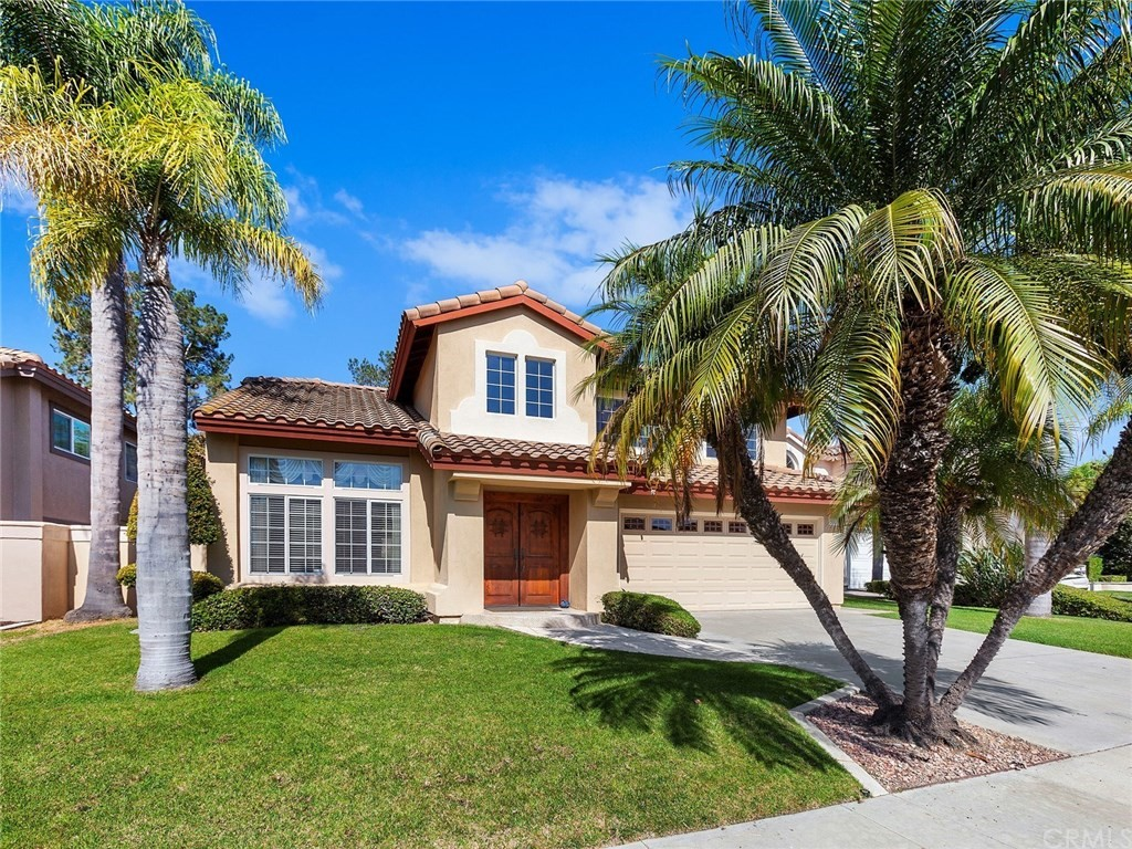Beautifully upgraded home in the Bel Air community that has been completely remodeled.  Located on a cul de sac with a large private yard with patio and grassy lawn area. Gorgeous upgraded double door entry w/custom lighting & cathedral ceilings.  Wood floors and travertine flooring with stone accents & custom base boards throughout.  Elegant living room & separate dining room for formal entertaining.  Custom kitchen with knotty Alder cabinets with pull out drawers, decorative handles, & trim molding, granite counters, high end appliances featuring a high BTU stainless steel built-in cook top and separate built-in oven, Fisher & Packel dishwasher, built in side by side refrigerator with wood panel door. Family room features a custom gas fireplace. Downstairs bath is venetian plaster, custom lighting, vanity and sink. Upstairs master suite with vaulted ceilings, 2 closets w/mirrored closet doors & recessed lighting.  Large shower with stone tile surround, custom vanity, mirrors & lighting.  Located in a desirable location, short distance to Bathgate Elementary School.  Mission Viejo Lake membership where you can enjoy 2 beaches, boating, fishing, concerts, events and more.  Low tax rate and no mello roos.