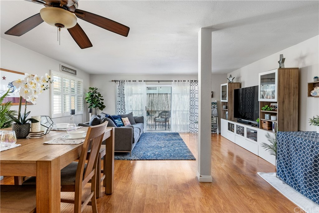 Beautiful, gleaming wood floors and smooth ceilings create a comfortable, open-concept living space.