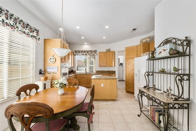 Kitchen over looks casual dining room