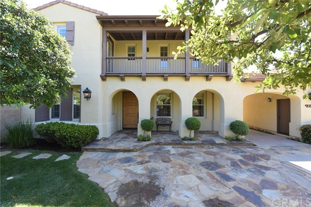 An AMAZING estate situated on premier corner lot with private long drive way in the Gated Community of Emerson.   This beautiful Tuscany home features UNIQUE CHARACTERS with a spacious and functional floor plan of 5 bedrooms, 4 bath and 3 car garage… Separate living room with soaring ceilings… Main floor bedroom/office adjacent with full bath… Formal dining room open into the court yard… Large family room with built-ins and fireplace… Gourmet kitchen with top of the line appliances, center island and breakfast nook… Entertaining and lush landscaping backyard features build-in BBQ, pool, spa, patio and huge flat lawn area…Private Master Bedroom with balcony overlooking mountain and city light view… Tastefully upgraded with hardwood flooring, neutral carpet, designer's paint, recessed lighting, window covering & etc….No detail has been overlooked in making this one of the kind home.  Great Schools and Easy Access to shopping, dining, freeways, Peters Canyon hiking/biking trails and Tustin Ranch Golf Course.  Don't miss the opportunity to make this your new home!!