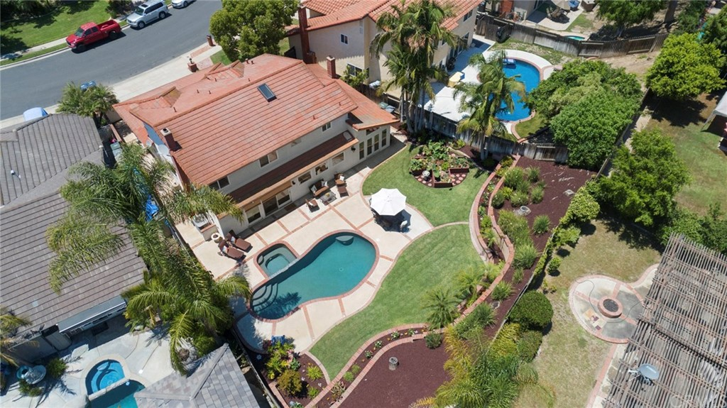 An Entertainers Dream! At appx 2706 sqft, this beautiful Lake Forest pool home sits on an appx 9100 sqft cul-de-sac lot.Double door entry is through your privately gated court yard.Enter into soaring ceilings, formal living room w fireplace, formal dining room w french doors to the back yard.Large family room w built in entertainment center, LED lights, cozy fireplace and granite counter wet bar.Lg gourmet kitchen w  custom cabinets, massive granite eat at island and workspace, stainless gourmet Thermador Professional stove,stainless GE double Oven, Built in Sub-Zero refrigerator and 145 bottle wine refrigerator.Stainless microwave, trash compactor, dishwasher and sink. Downstairs bedroom w ceiling fan, closet organizers & mirrored wardrobe doors,remodeled downstairs bath w pedestal sink, custom tile & shower w glass enclosure, large secondary bedrooms upstairs w ceiling fans & mirrored wardrobe doors. Large master suite w vaulted ceiling, ceiling fan.LG mstr bath w dual vanity's w granite counter, jacuzzi tub custom flooring & shower.Huge walk-in closet w organizers.A very private entertainers back yard w beautiful pool & Spa, large patio, lush landscaping & Lg grassy area. 3 car garage w built in office. This home has it all! New carpet, new paint, stone flooring, custom gourmet kitchen,bed & bath down, pool&spa, private back yard, 3 car garage & cul de sac location! HOA w 2 pools, tennis courts and clubhouse!