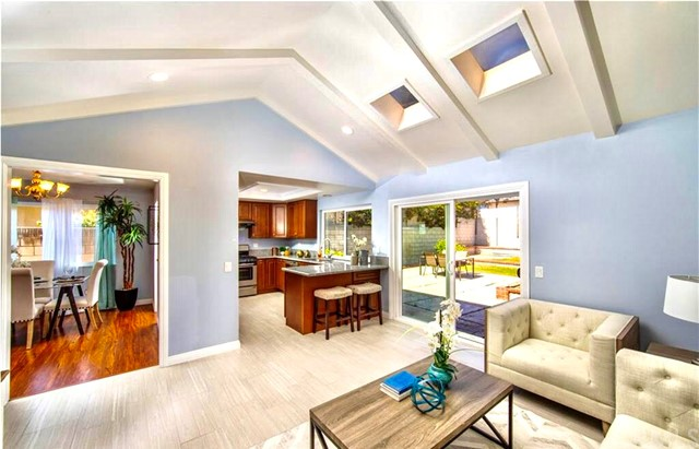"""GREAT INVESTMENT OPPORTUNITY!! This beautiful ONE LEVEL single family residence is located in a neighborhood that's only 5 minutes away from Irvine. It has the LARGEST floor plan in the neighborhood with four bedrooms and three full bathrooms including TWO (2) MASTER SUITE BEDROOMS. This home was completely remodeled with a permitted addition in 2017. Features include new flooring, recessed lighting, new appliances, custom tile showers and new windows. Chef's kitchen included gas range/oven, granite countertops, loads of counter space, stainless steel appliances and opens to the family room with vaulted ceiling and skylight. Spacious room behind the master bedroom that can be used as either a personal office or children's room. The layout and floor plan make it IDEAL FOR INVESTORS and/or PERFECT FOR GUESTS, IN-LAWS OR MULTI-GENERATIONAL FAMILIES. Easy access to both I-5 and 55 freeways and takes no more than 5 minutes to both 'The District"""" and """"Marketplace"""". With NO HOA OR MELLO ROOS."""