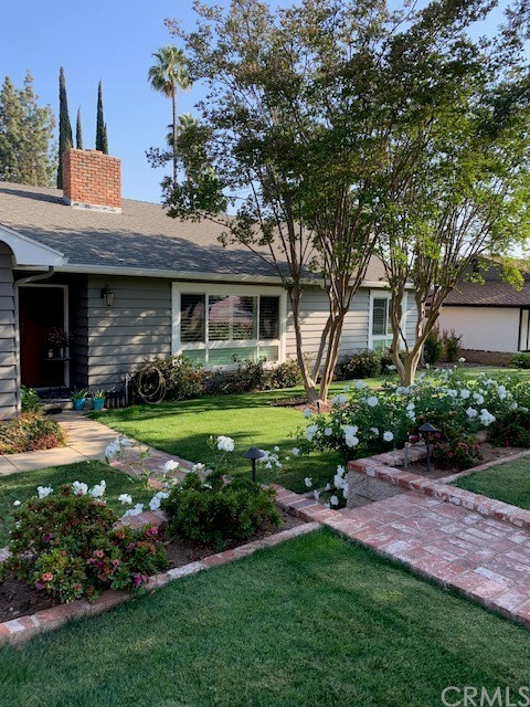 """Wonderful single-story home in South Redlands. Completely renovated from top to bottom. Open floorplan with quality finishes. This home has all the amenities you could ask for including: hardwood floors throughout; entertainer's kitchen with huge center island and eating counter; custom kitchen cabinets with soft-close drawers; stainless steel appliances including refrigerator, dishwasher, microwave, disposal, range, oven, and wine fridge; quartz counter tops; remodeled baths; wood shutters in living room; updated energy efficient windows; and central heat/ac. Very private yard with professionally """"manicured"""" landscaping, in-ground pool, and rear patio. Pride of ownership shows everywhere you look. Great location with easy access to neighborhood shopping and the best Redlands schools. Walk to Prospect Park! Some furnishings are negotiable. Professionally managed."""